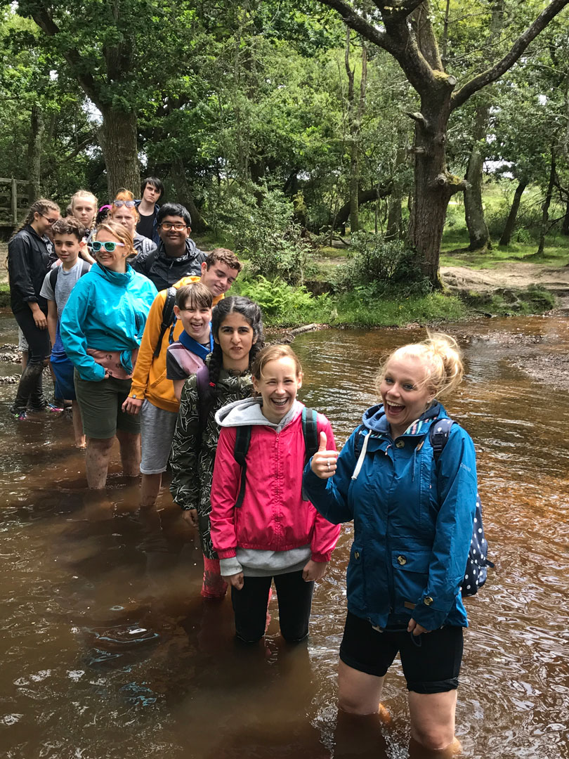 Year 8 Camp wading through the river!